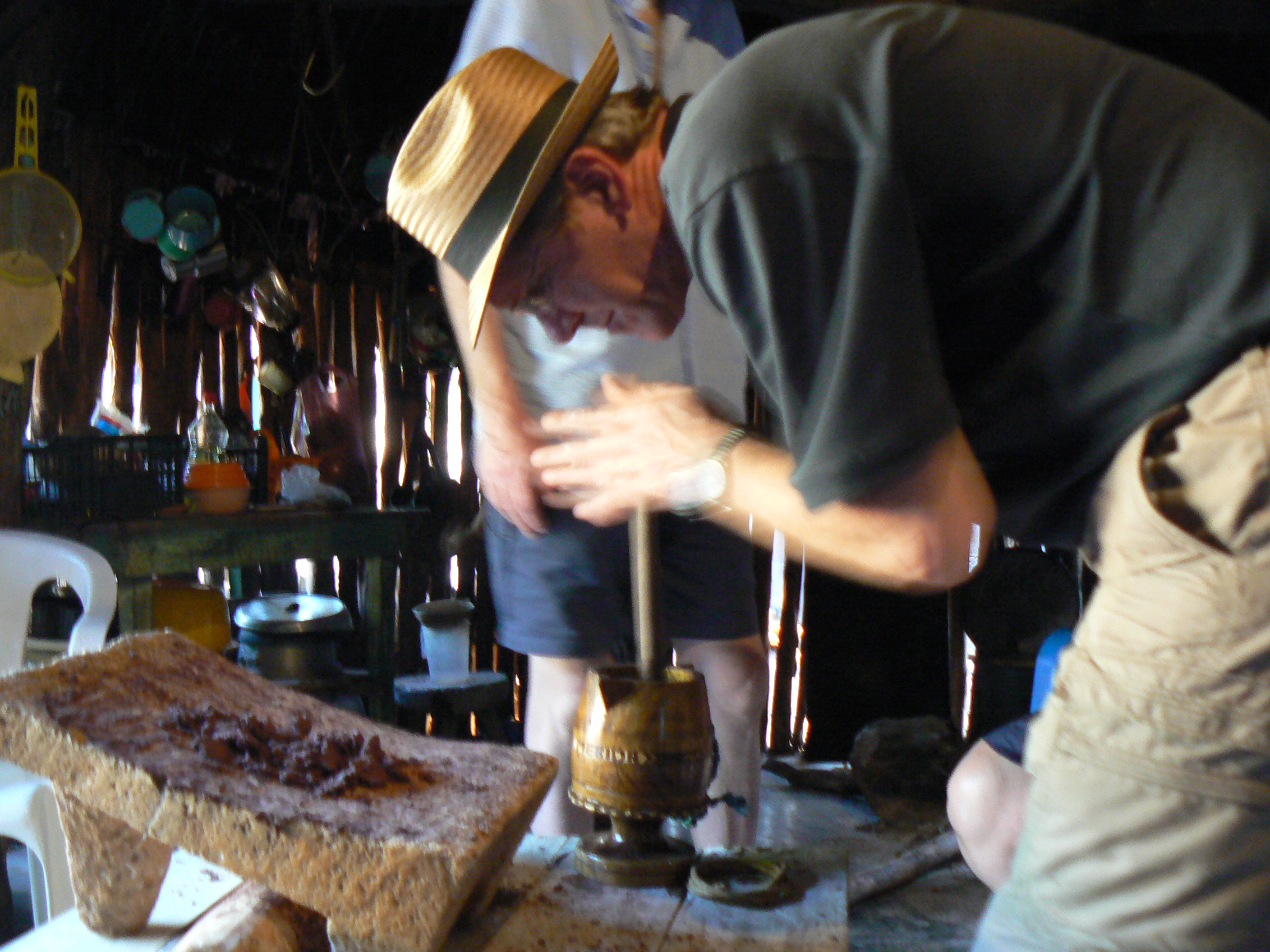 making cocoa in the tradtional Mayan way.